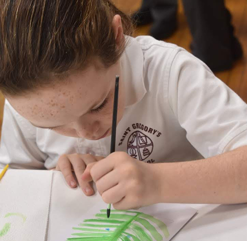 Student writing and learning at the top private school in the Capital Region