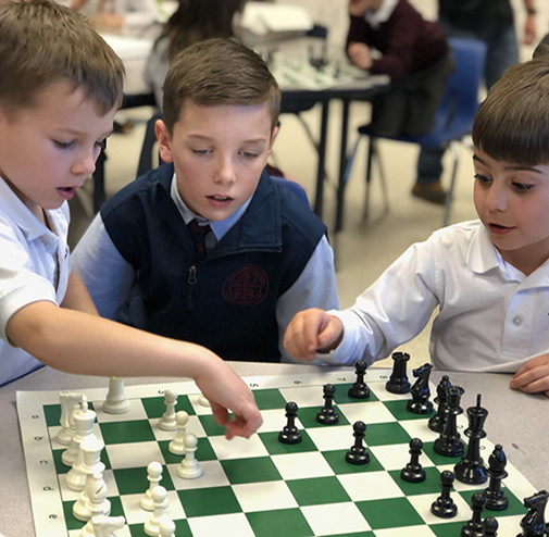 Students participating in chess club at the best private school in Albany
