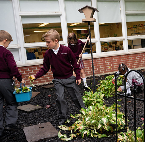 Students gardening at the top private school in the Capital Region